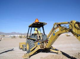 Staff Member Operating Heavy Equipment