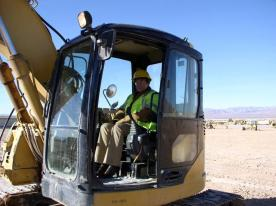 Employees Operating Heavy Equipment